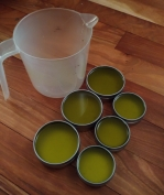 Filling tins with measuring cup.